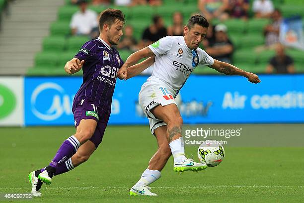 Robert Koren of Melbourne City controls the ball under pressure from Chris Harold of Perth Glory during the round 18 ALeague match between Melbourne...