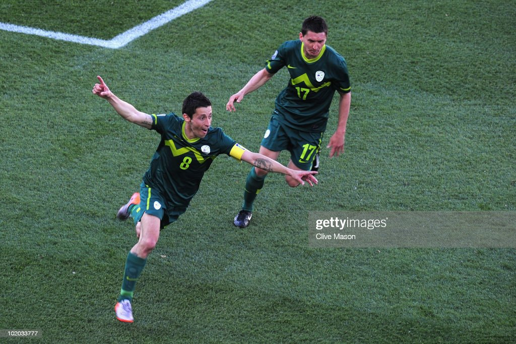 Robert Koren of Slovenia (L) celebrates after scoring the first goal during the 2010 FIFA World Cup South Africa Group C match between Algeria and Slovenia at the Peter Mokaba Stadium on June 13, 2010 in Polokwane, South Africa.
