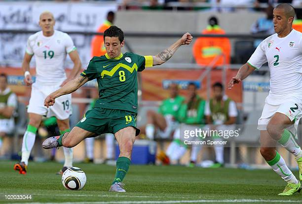 Robert Koren of Slovenia shoots and scores the opening goal during the 2010 FIFA World Cup South Africa Group C match between Algeria and Slovenia at...