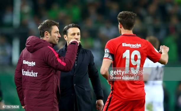 Robert Kovac assistant coach of Frankfurt talks to David Abraham of Frankfurt during the DFB Cup semi final match between Borussia Moenchengladbach...