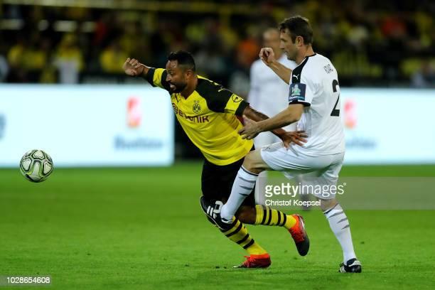 Robert Kovac of Roman and Friends challenges Antonio da Silva of Borussia Dortmund Allstars during the Roman Weidenfeller Farewell Match between...