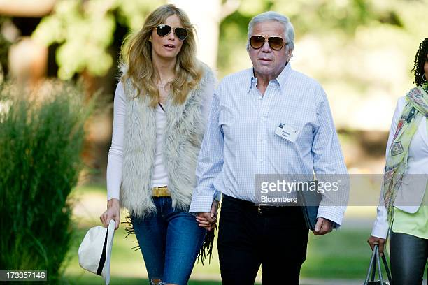 Robert Kraft chairman and chief executive officer of The Kraft Group and owner of the New England Patriots holds hands with actress Ricki Lander as...