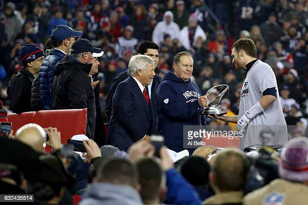 Robert Kraft owner and CEO of the New England Patriots head coach Bill Belichick and Tom Brady celebrate with the Lamar Hunt Trophy after defeating...