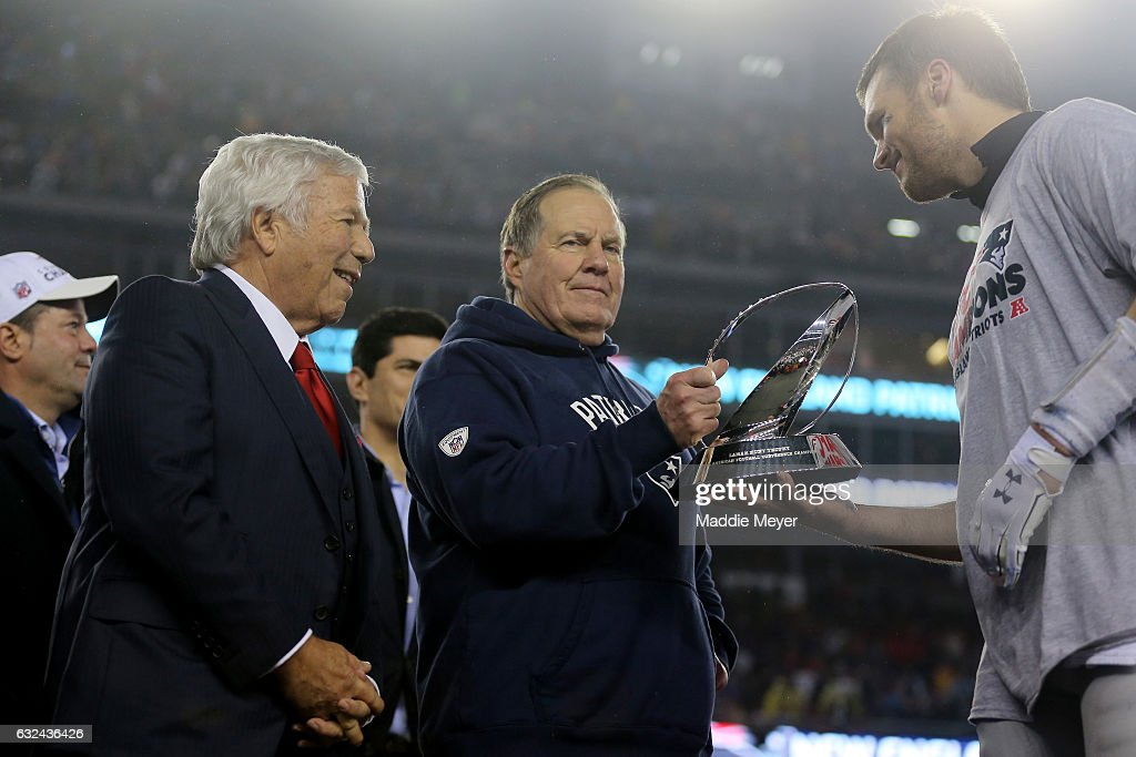 Robert Kraft, owner and CEO of the New England Patriots, head coach Bill Belichick of the New England Patriots and Tom Brady #12 celebrate with the Lamar Hunt Trophy after defeating the Pittsburgh Steelers 36-17 to win the AFC Championship Game at Gillette Stadium on January 22, 2017 in Foxboro, Massachusetts.
