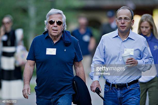 Robert Kraft owner of the New Englad Patriots left walks with Jonathan Kraft president of The Kraft Group while arriving for a morning session during...