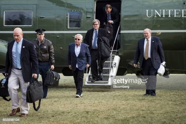 Robert Kraft owner of the New England Patriots LP center and Steve Bannon chief strategist for US President Donald Trump walk off Marine One on the...