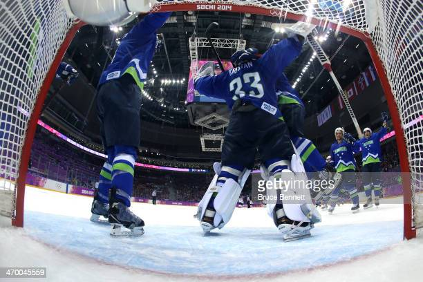Robert Kristan of Slovenia celebrates with teammate Rok Ticar of Slovenia after defeating Austria 4 to 0 in the Men's Ice Hockey Qualification...