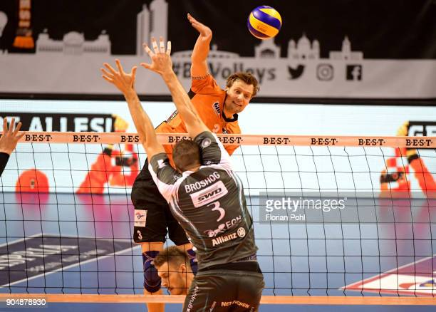 Robert Kromm of the Berlin Recycling Volleys and Tim Broshog of SWD Dueren during the game between the Berlin Recycling Volleys and the SWD...
