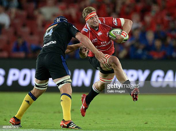 Robert Kruger of the Lions drives into Mark Abbott during the Super Rugby match between Emirates Lions and Hurricanes at Emirates Airline Park on...