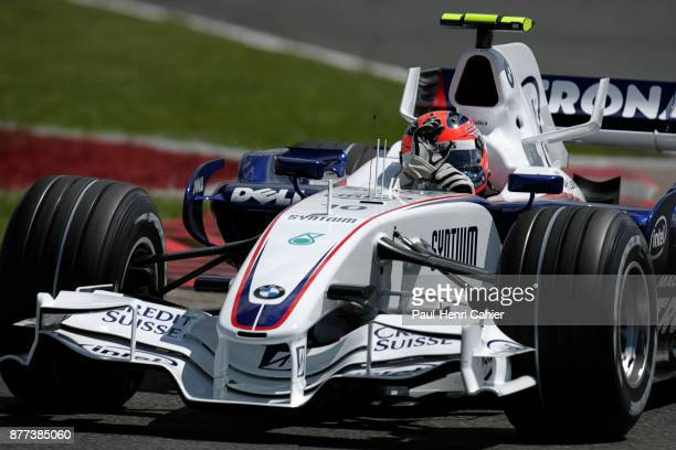 Robert Kubica, BMW Sauber F1.07, Grand Prix of Great Britain, Silverstone Circuit, 08 July 2007. Robert Kubica waves at the crowd during his slowing...