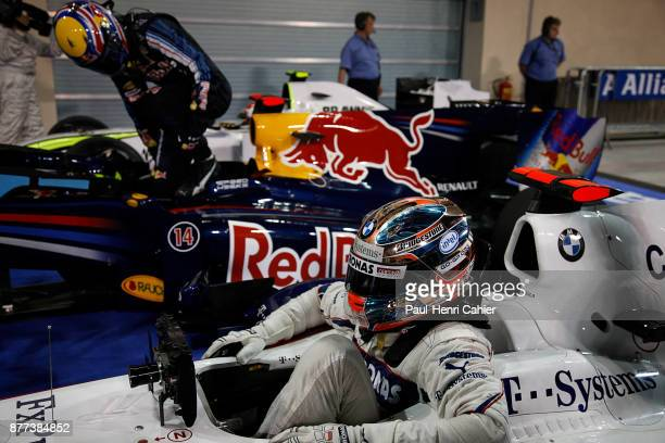 Robert Kubica Mark Webber BMW Sauber F109 Red BullRenault RB5 Grand Prix of Abu Dhabi Yas Marina Circuit 01 November 2009 Robert Kubica and Mark...