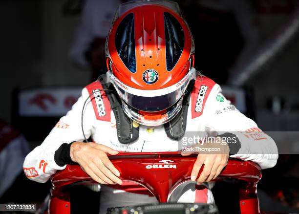 Robert Kubica of Poland and Alfa Romeo Racing prepares to drive in the garage during day one of Formula 1 Winter Testing at Circuit de...