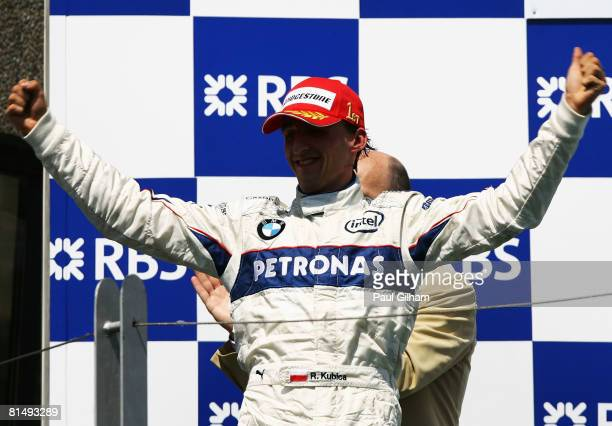 Robert Kubica of Poland and BMW Sauber celebrates on the podium following his victory in the Canadian Formula One Grand Prix at the Circuit Gilles...