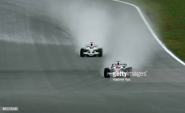 Robert Kubica of Poland and BMW Sauber drives ahead of Jenson Button of Great Britain and Honda Racing during the final practice session before...