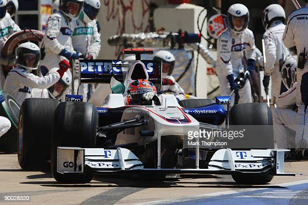 Robert Kubica of Poland and BMW Sauber drives in for a pitstop during the European Formula One Grand Prix at the Valencia Street Circuit on August 23...