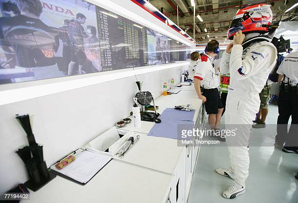 Robert Kubica of Poland and BMW Sauber is seen in his garage during practice for the Chinese Formula One Grand Prix at the Shanghai International...