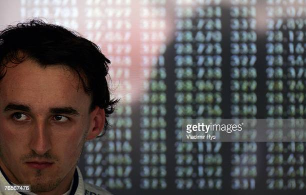 Robert Kubica of Poland and BMW Sauber looks on in his garage during practice for the Italian Formula One Grand Prix at the Autodromo Nazionale di...
