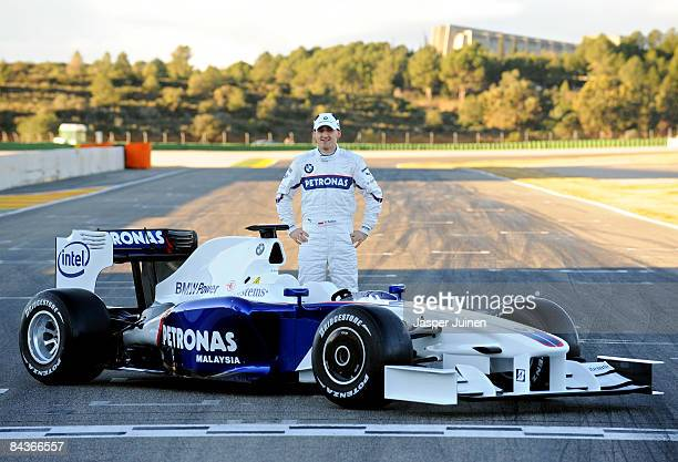 Robert Kubica of Poland and BMW Sauber poses with the new BMW Sauber F1.09 formula one car at the Ricardo Tormo racetrack on january 20, 2009 in...