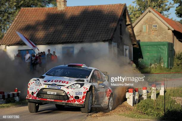 Robert Kubica of Poland and Maciej Szczepaniak compete in their RK MSport Ford Fiesta RS WRC during Day One of the WRC Poland on June 27 2014 in...