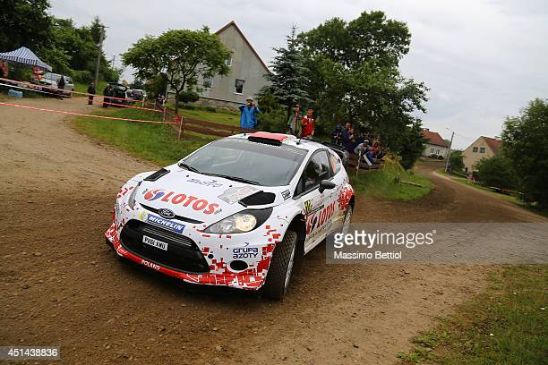 Robert Kubica of Poland and Maciej Szczepaniak of Poland compete in their RK MSport WRT Ford Fiesta RS WRC during Day Three of the WRC Poland on June...