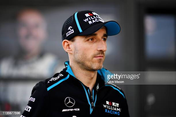 Robert Kubica of Poland and Williams looks on in the Paddock during previews ahead of the F1 Grand Prix of Australia at Melbourne Grand Prix Circuit...