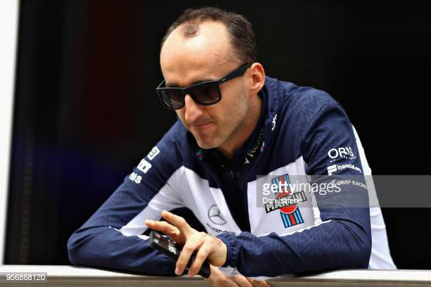 Robert Kubica of Poland and Williams looks on in the Pitlane during previews ahead of the Spanish Formula One Grand Prix at Circuit de Catalunya on...