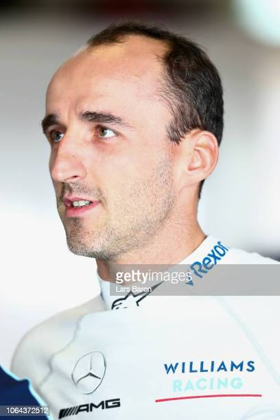 Robert Kubica of Poland and Williams prepares to drive in the garage during practice for the Abu Dhabi Formula One Grand Prix at Yas Marina Circuit...