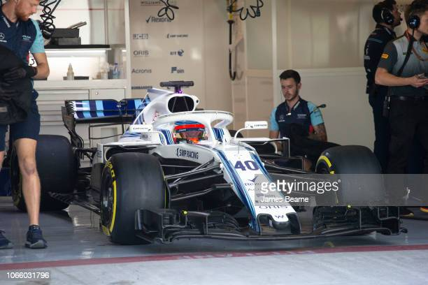 Robert Kubica of Poland and Williams prepares to drive in the garage during day two of F1 End of Season Testing at Yas Marina Circuit on November 28...
