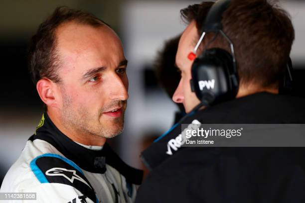Robert Kubica of Poland and Williams prepares to drive in the garage during final practice for the F1 Grand Prix of China at Shanghai International...