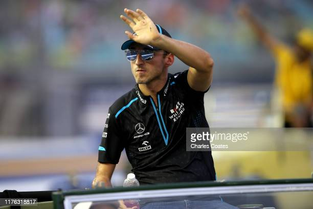 Robert Kubica of Poland and Williams waves to the crowd on the drivers parade before the F1 Grand Prix of Singapore at Marina Bay Street Circuit on...