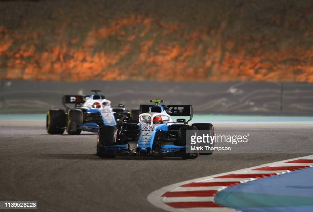 Robert Kubica of Poland driving the Rokit Williams Racing FW42 Mercedes leads George Russell of Great Britain driving the Rokit Williams Racing FW42...