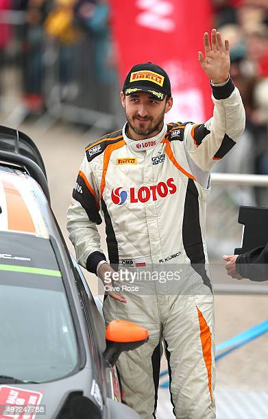 Robert Kubica of Poland waves to the crowd during the finishing ceremony of the FIA World Rally Championship Great Britain on November 15 2015 in...