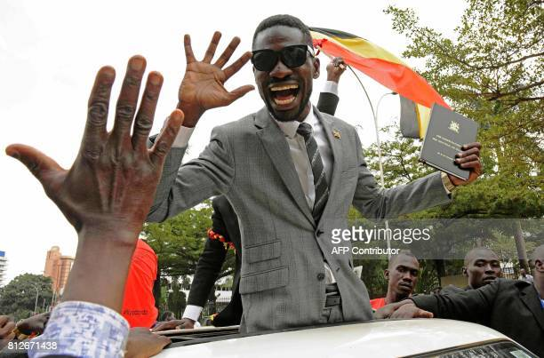 TOPSHOT Robert Kyagulani commonly known as Bobi Wine waves to his supporters moments after being sworn in as a Ugandan Member of Parliament on July...