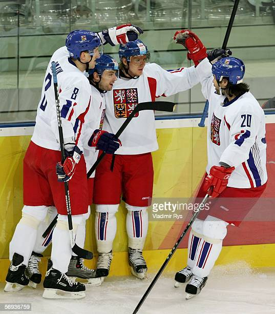 Robert Lang of Czech Republic celebrates with Marek Malik and Martin Erat after Erat's goal during the first period at the bronze medal match of the...