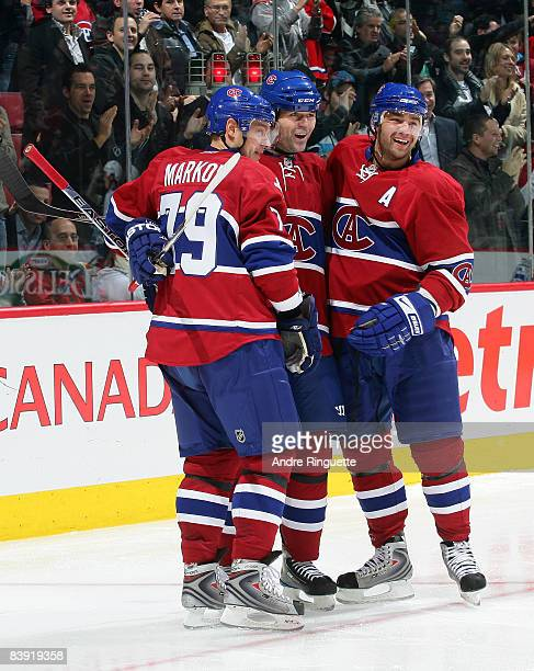 Robert Lang of the Montreal Canadiens celebrates his goal against the New York Rangers with teammates Andrei Markov and Christopher Higgins at the...