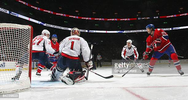 Robert Lang of the Montreal Canadiens roofs a shot over Brent Johnson of the Washington Capitals for a 3rd period goal during their NHL game at the...