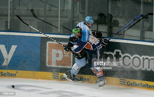 Robert Leask of Hamburg tackles Christian Laflamme of Nuremberg during the DEL match between Sinupret Ice Tigers and Hamburg Freezers at the Arena...