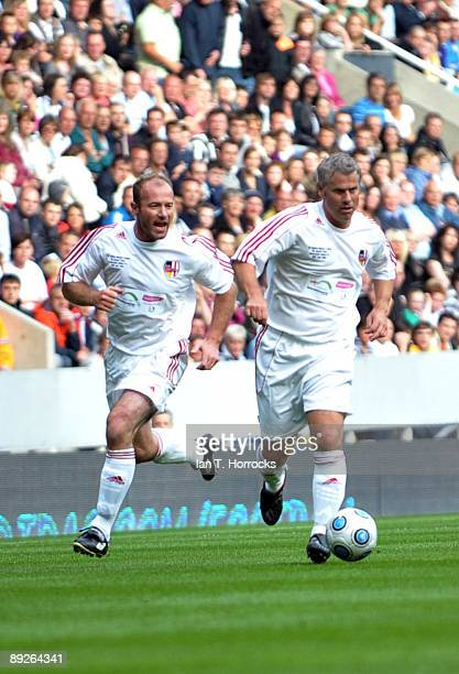 Robert Lee and Alan Shearer in action during the England v Germany charity match in aid of the Bobby Robson Foundation at St James' Park on July 26...