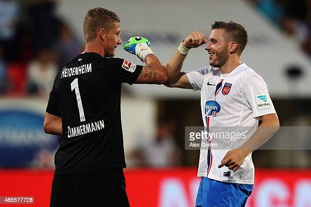 Robert Leipertz of Heidenheim celebrates his team's fourth goal goalkeeper Jan Zimmermann during the Second Bundesliga match between 1. FC Heidenheim...