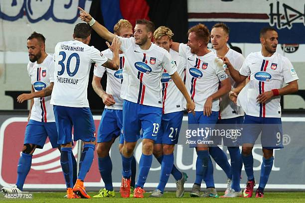 Robert Leipertz of Heidenheim celebrates his team's fourth goal with team mates during the Second Bundesliga match between 1. FC Heidenheim and 1. FC...
