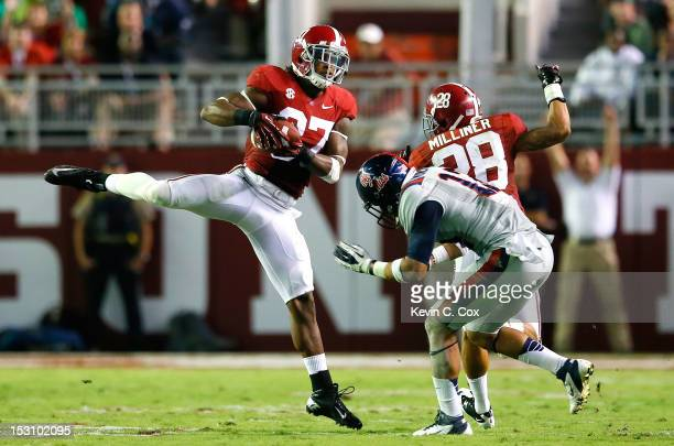 Robert Lester of the Alabama Crimson Tide intercepts a pass intended for Donte Moncrief of the Mississippi Rebels at BryantDenny Stadium on September...