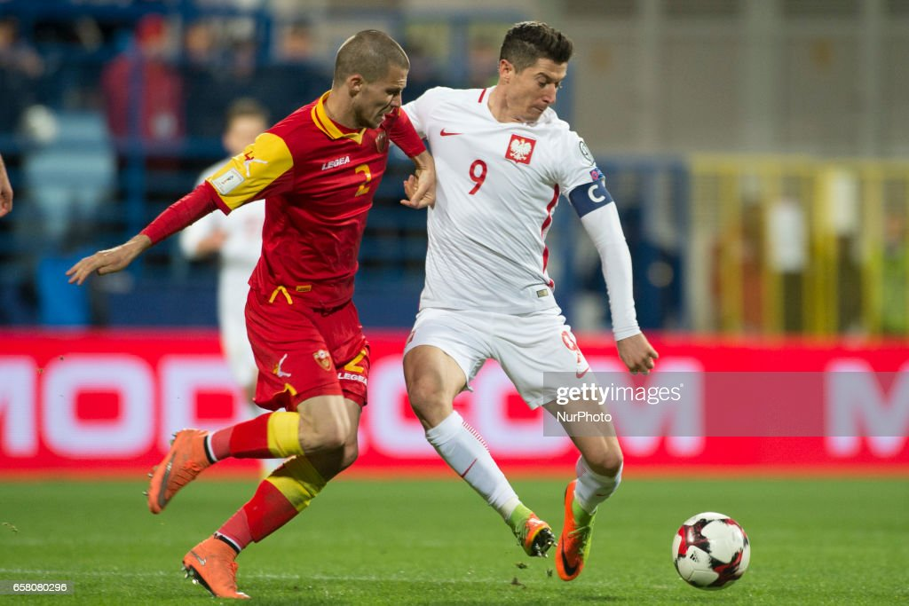 Robert Lewandoeski of Poland and Aleksandar Sofranac of Montenegro fight for the ball during the FIFA World Cup 2018 Qualifying Round Group E match between Montenegro and Poland at Gradski Stadion in Podgorica, Montenegro on March 26, 2017