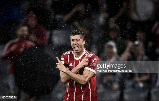 Robert Lewandowksi of FC Bayern Muenchen celebrates after scoring his team's third goal during the Bundesliga match between FC Bayern Muenchen and...