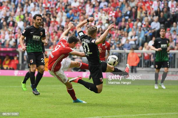 Robert Lewandowksi of FC Bayern Muenchen scores his team's first goal during the Bundesliga match between Bayern Muenchen and FC Augsburg at Allianz...