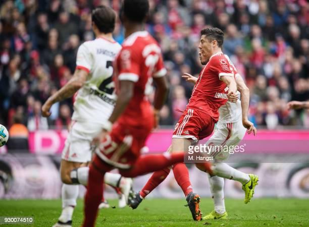 Robert Lewandowksi of FC Bayern Muenchen scores his team's third goal during the Bundesliga match between FC Bayern Muenchen and Hamburger SV at...