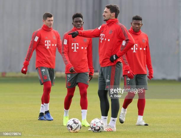 Robert Lewandowski Alphonso Davies Mats Hummels and David Alaba of FC Bayern Muenchen practice during a training session at the club's Saebener...