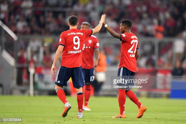 Robert Lewandowski and David Alaba of Bayern Muenchen clap hands during the friendly match between Bayern Muenchen and Manchester United at Allianz...