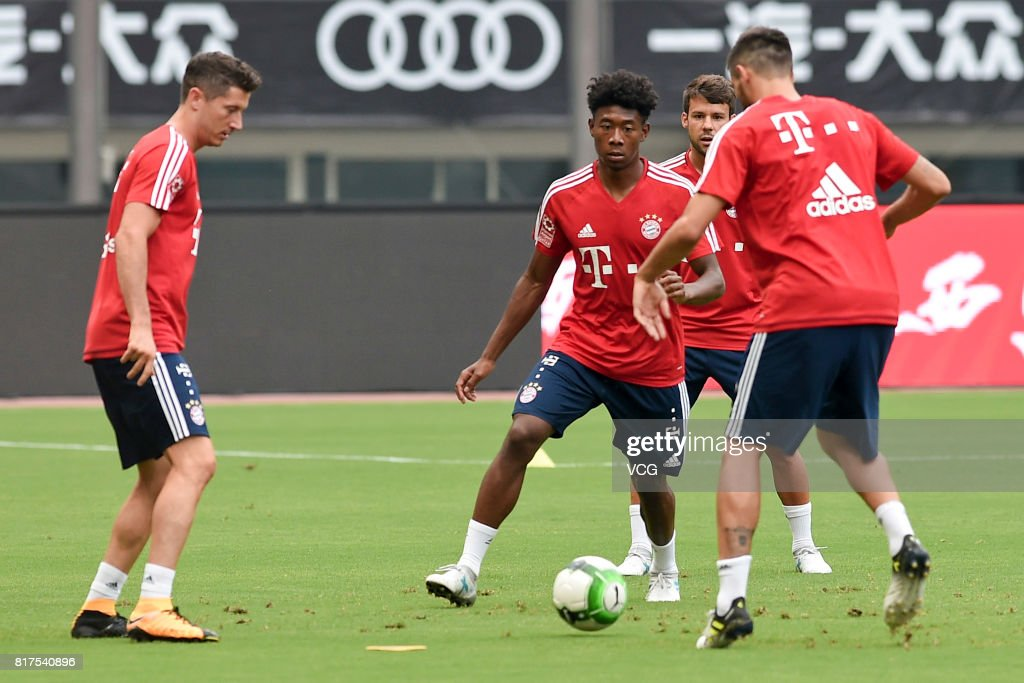 Robert Lewandowski (L) and David Alaba (2nd L) of FC Bayern Muenchen in action during a training session ahead of 2017 International Champions Cup China between FC Bayern Muenchen and Arsenal at Shanghai Stadium on July 18, 2017 in Shanghai, China.