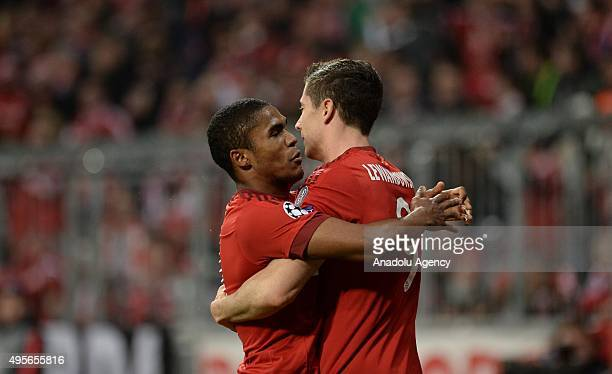 Robert Lewandowski and Douglas Costa of Bayern Munich celebrate a goal during the UEFA Champions League group F soccer match between FC Bayern Munich...