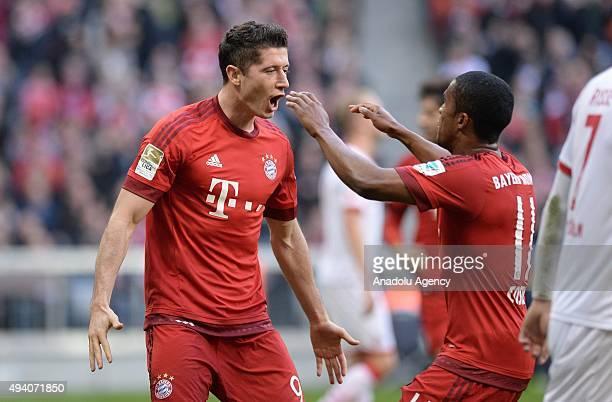 Robert Lewandowski and Douglas Costa of Bayern Munich celebrates the 30 during the Bundesliga soccer match between FC Bayern Munich and 1 FC Cologne...